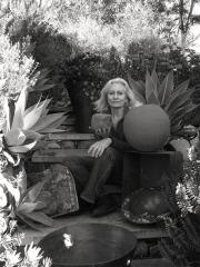 Artist Yolande Clarkson with her work.