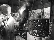 Sam Larwill welding his metal work.